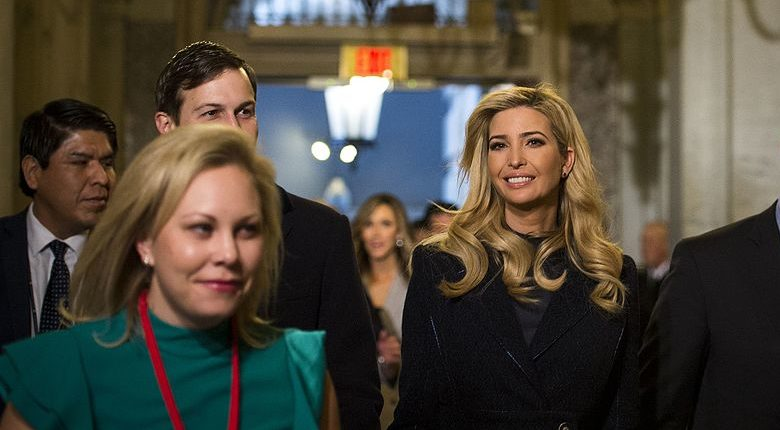 A smiling Ivanka Trump walks down a Capitol hallway with her husband Jared
